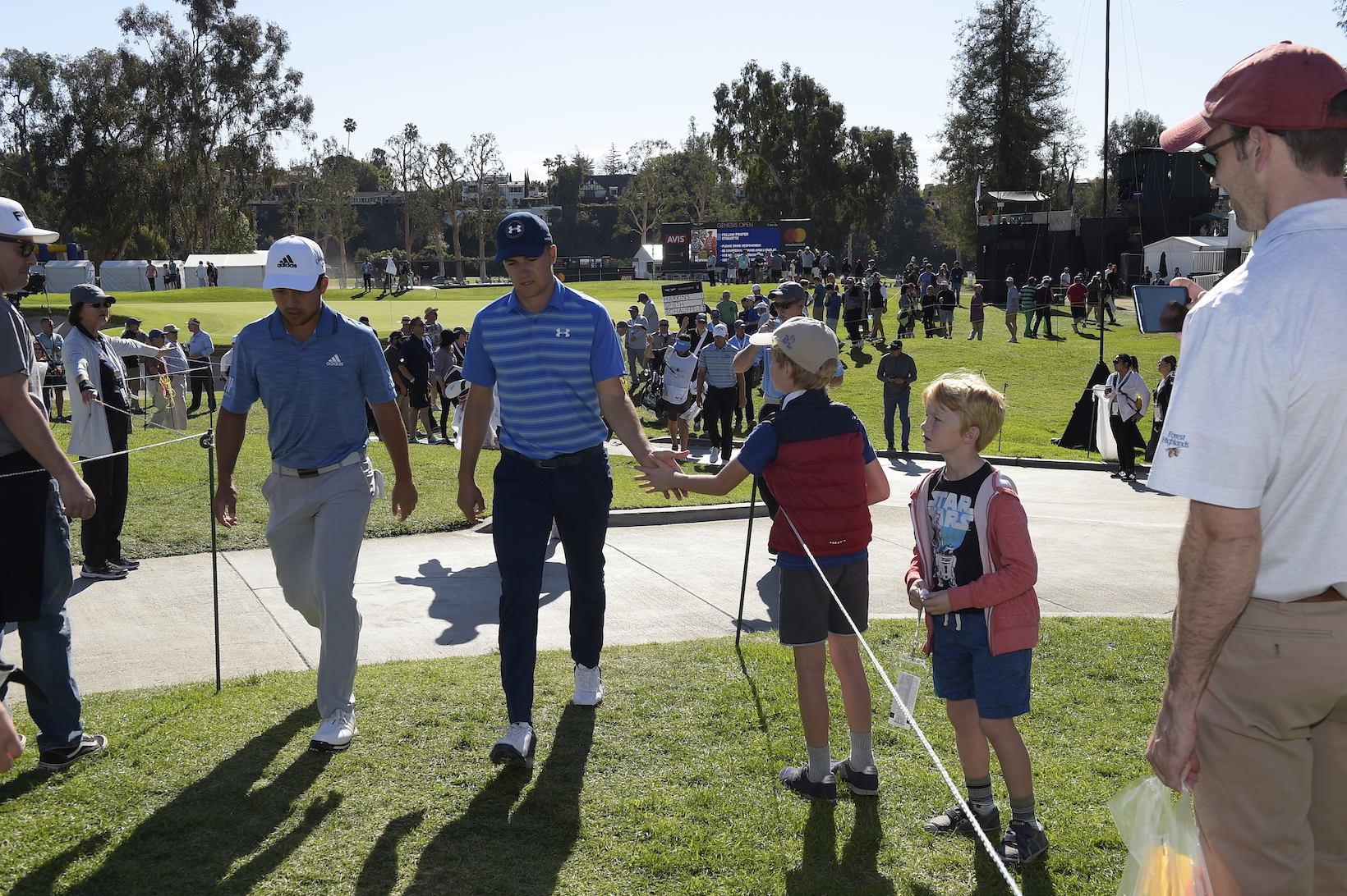 2018 Genesis Open: Round 3 - Xander Schauffele and Jordan Spieth With Fans on No. 3
